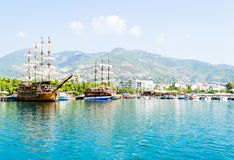 Beautiful wooden ships in the Mediterranean sea, Turkey. Beautiful wooden ships sailing in the Mediterranean sea against the mountains of Turkey Stock Photo