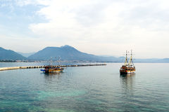 Beautiful wooden ships in the Mediterranean sea, Turkey. Beautiful wooden ships sailing in the Mediterranean sea against the mountains of Turkey Royalty Free Stock Photos