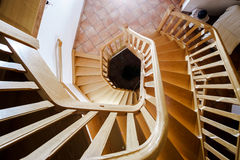 Beautiful wooden spiral staircase Stock Photo