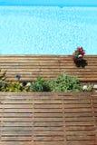 Beautiful wooden terrace around swimming pool Stock Photo