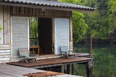 Beautiful wooden terrace or balcony with two chair near beach, Thailand Stock Photo