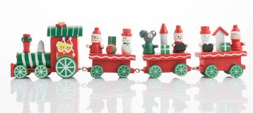 Wooden toy train with colorful blocs isolated. Beautiful wooden toy train with colorful blocs isolated royalty free stock photography