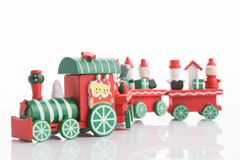 Wooden toy train with colorful blocs isolated. Beautiful wooden toy train with colorful blocs isolated stock images