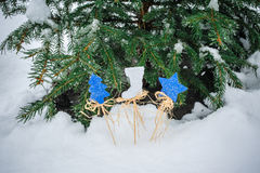Beautiful wooden toys near a Christmas tree Royalty Free Stock Photos