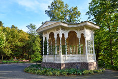 Beautiful wooden white arbour. In a city forest park Stock Photo