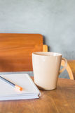 Beautiful wooden work table with cup of coffee Stock Image