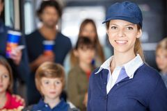 Beautiful Worker With Families In Background At Stock Images