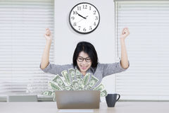 Beautiful worker with money on laptop Royalty Free Stock Photo
