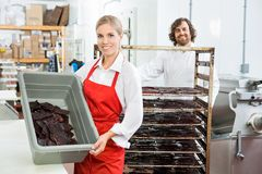 Beautiful Worker Showing Beef Jerky In Basket At Stock Photography
