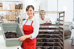 Beautiful Worker Showing Beef Jerky In Basket At Stock Images