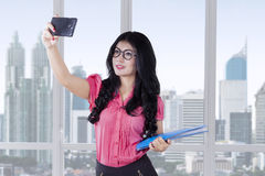 Beautiful worker taking selfie in the office Royalty Free Stock Photography
