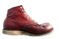 Beautiful worn leather boot. A red leather beautiful worn fashion boot. seen from the side. Vintage look without laces. In the center isolated on a white Stock Photos