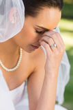 Beautiful worried bride at park Stock Photo