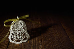 Beautiful woven from yarn bell on the wooden background Stock Photos