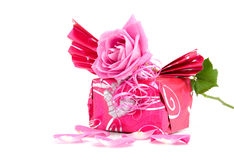 Beautiful wrapped gift with rose Stock Photography