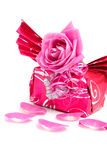 Beautiful wrapped gift with rose Royalty Free Stock Image