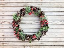 Beautiful wreath on the wooden background Stock Image