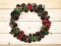 Beautiful wreath on the wooden background Royalty Free Stock Photos