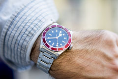 Beautiful wristwatch for men. Wristwatch on a male model's hand showing time Royalty Free Stock Images