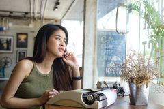 Beautiful writer looking out window, work lifestyle. Concept Royalty Free Stock Photo