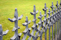 Beautiful wrought fence. Image of a decorative cast iron fence. Metal fence close up. Stock Images