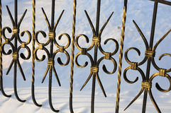 Beautiful wrought fence. Image of a decorative cast iron fence. metal fence close up.  beautiful fence with artistic forging Stock Photo