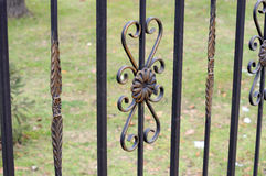 Beautiful wrought fence. Image of a decorative cast iron fence. metal fence close up. beautiful fence with artistic forging Royalty Free Stock Photos