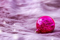 Beautiful xmas ornaments on pink fur background with space for text. Merry christmas Royalty Free Stock Image