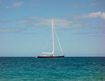 A beautiful yacht anchored at lower bay, bequia. A sleek vessel moored at a popular tourist destination in the windward islands Stock Image