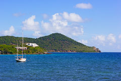 Beautiful yacht near the tropical islands in Caribbean Sea. Stock Image