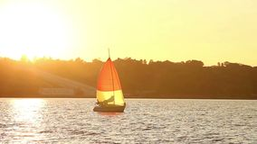 Beautiful yacht on sea at sunset, sailing under wind, sports. Stock footage stock video footage