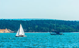 Beautiful yachts in the bay, sailing on the ocean, clear sky,  Stock Photos
