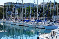 Beautiful yachts on a sparkling blue sea in Cannes, France Stock Photos