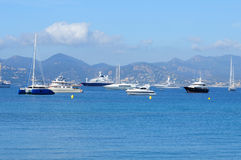 Beautiful yachts on a sparkling blue sea in Cannes, France Stock Images