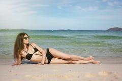 Beautiful yang woman on the beach Stock Photos