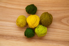 A beautiful yarn balls in vibrant colorful tones. On wooden background Stock Photo