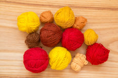 A beautiful yarn balls in vibrant colorful tones. On wooden background Stock Images