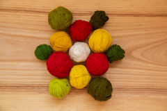A beautiful yarn balls in vibrant colorful tones. On wooden background Stock Photography