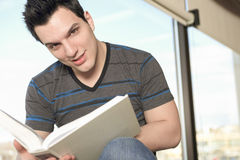 A beautiful 20 yars old men student studying. A beautiful 20 yars old man student studying with a book Stock Photography