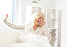 Beautiful yawning woman just after waking up Royalty Free Stock Photography