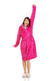 Beautiful yawning woman in pink bathrobe. Royalty Free Stock Photography