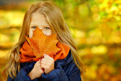 Beautiful 6 year old blonde girl with long hair hides her face b Royalty Free Stock Images