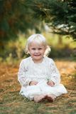 Beautiful Little Girl Child Smiling and Posing Outside under the Stock Photography