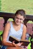 Beautiful 15 year old teenager with open book. Beautiful teenager with an open book on the nature Royalty Free Stock Images