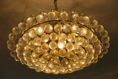 Beautiful yellow chandelier. Big luxury chandelier with lot of crystals Royalty Free Stock Photography