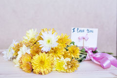 Beautiful  yellow  chrysanthemums bouquet with i love you card Stock Image