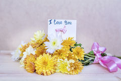 Beautiful  yellow  chrysanthemums bouquet with i love you card Stock Photos