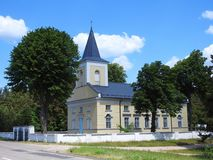 Beautiful yellow church near way, Lithuania Stock Image