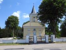 Beautiful yellow church near way, Lithuania Royalty Free Stock Images
