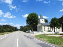 Beautiful yellow church near way, Lithuania Stock Photo